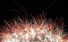 Stock-photo-colorful-fireworks-over-dark-sky-displayed-during-a-celebration-110661779