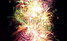 Stock-photo-firework-streaks-in-night-sky-celebration-background-59104141