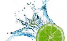 Stock-photo-fresh-lime-dropped-into-water-with-splash-isolated-on-white-29225563