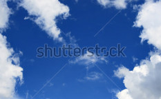 Stock-photo-blue-sky-and-frame-from-clouds-may-be-used-as-background-15348196