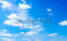 Stock-photo-blue-sky-background-with-white-clouds-117186019