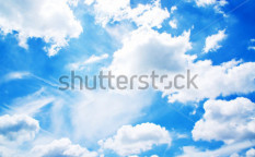 Stock-photo-fluffy-white-cloud-over-blue-background-102974903
