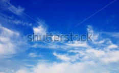 Stock-photo-sky-background-with-the-fluffy-white-clouds-129534101