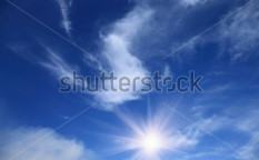 Stock-photo-summer-blue-sky-with-sun-and-clouds-58084330