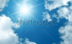 Stock-photo-sun-among-the-clouds-on-blue-sky-57730501
