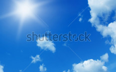 Stock-photo-sun-in-blue-sky-59735002