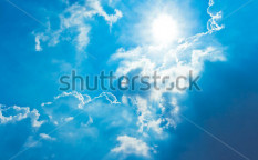 Stock-photo-sun-shine-in-blue-sky-62457430