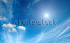 Stock-photo-sun-with-clouds-in-blue-sky-49749967