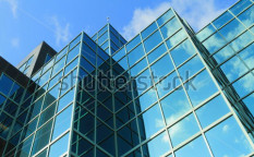 Stock-photo-a-modern-glass-fronted-building-47002969