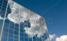 Stock-photo-clouds-reflected-in-windows-of-modern-office-building-10045708