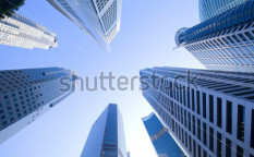 Stock-photo-look-to-the-sky-surrounded-by-skyscrapers-86145571