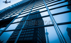 Stock-photo-modern-blue-glass-wall-of-skyscraper-122585395