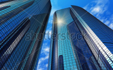 Stock-photo-modern-blue-reflective-office-buildings-73498384