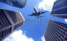 Stock-photo-modern-city-buildings-and-aircraft-in-brisbane-123349231