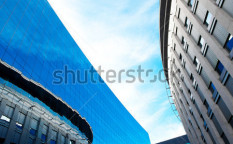 Stock-photo-modern-office-building-against-the-blue-sky-81003133