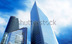 Stock-photo-modern-office-skyscrapers-on-the-sunny-beautiful-sky-58693714