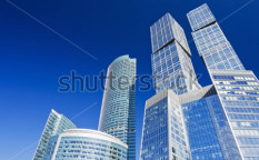 Stock-photo-modern-skyscrapers-on-a-background-of-blue-sky-55808557