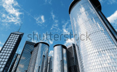 Stock-photo-skyscrapers-of-city-with-reflections-on-a-background-cloudy-sky-11737390