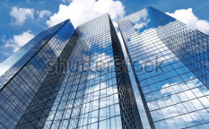Stock-photo-skyscrapers-with-clouds-reflection-59453413
