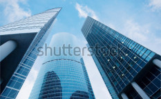 Stock-photo-three-skyscrapers-business-center-in-megalopolis-18594896