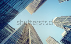 Stock-photo-toned-picture-of-canary-wharf-financial-district-in-london-65316913