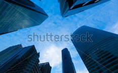Stock-photo-urban-buildings-skyscrapers-in-sky-on-dusk-background-97796186