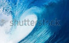 Stock-photo-beautiful-blue-surfing-wave-view-in-the-tube-26810704