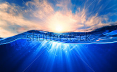 Stock-photo-design-template-with-underwater-part-and-sunset-skylight-splitted-by-waterline-123243373