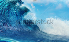 Stock-photo-ocean-view-seascape-breaking-surfing-ocean-wave-with-cloudy-sky-seagull-and-the-sun-79928758