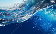 Stock-photo-ocean-view-seascape-landscape-with-blue-sky-and-sunlight-big-curly-ocean-wave-splitted-by-waterline-97243034