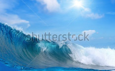 Stock-photo-submerged-image-breaking-surfing-ocean-foamy-wave-cloudy-sky-the-sun-82417414