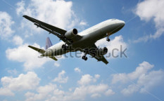 Stock-photo--airplane-above-the-clouds-93769345