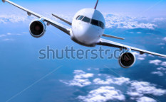 Stock-photo-airplane-above-the-clouds-3885595