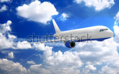 Stock-photo-airplane-in-a-sky-with-clouds-78356389