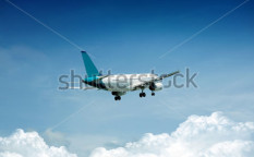 Stock-photo-airplane-on-blue-sky-106021646