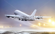 Stock-photo-airport-and-white-plane-at-non-flying-weather-blowing-snow-94244692