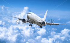 Stock-photo-big-jet-plane-above-clouds-63094048