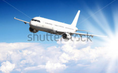 Stock-photo-big-jet-plane-flying-above-clouds-101937142