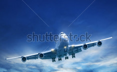 Stock-photo-jet-aircraft-in-a-sky-after-the-sunset-square-composition-in-high-resolution-92901616
