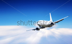 Stock-photo-jet-plane-flying-above-clouds-91727771