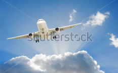 Stock-photo-large-passenger-airplane-flying-in-the-blue-sky-91988561