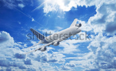 Stock-photo-large-passenger-plane-flying-in-the-blue-sky-114441226