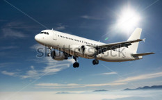 Stock-photo-large-passenger-plane-flying-in-the-blue-sky-72920593
