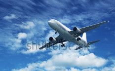Stock-photo-passenger-jet-air-plane-flying-on-blue-sky-white-clouds-background-117385111