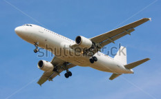 Stock-photo-plane-on-blue-sky-113949295