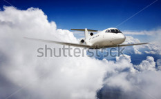 Stock-photo-private-jet-plane-in-the-blue-sky-113864026