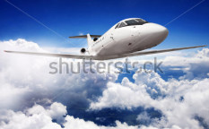 Stock-photo-private-jet-plane-in-the-blue-sky-119669851