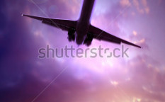 Stock-photo-silhouette-of-a-plane-flying-over-the-city-at-dusk-3617121