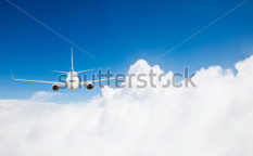 Stock-photo-the-airplane-with-the-blue-sky-background-60966715