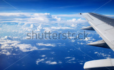 Stock-photo-view-from-the-airplane-window-ocean-blue-122386135